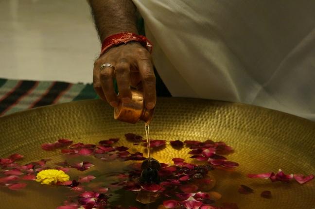 Mohanji doing shiva lingam abishek