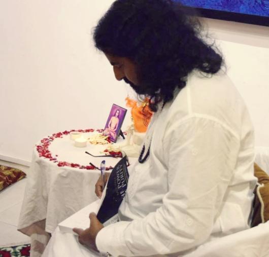 Mohanji giving blessing through