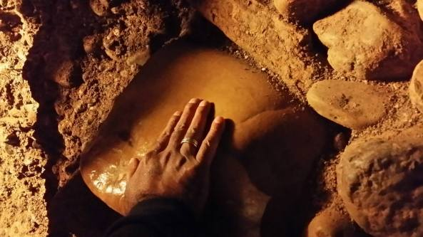 Mohanji touching the megalit in the labyrinth Ravne, network of tunnels around the pyramid