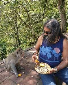Mohanji feeding a monkey - Interview with Mohanji
